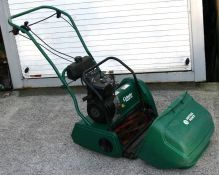 A Suffolk Punch petrol cylinder mower with 40cms (16ins) cut, instructions and original bill of sale