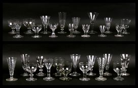 A quantity of 18th / 19th century wine glasses and similar glasses.