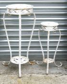 A white painted metal plant stand, 76cms (30ins) high; together with a matching smaller (2).