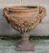 A terracotta urn of classical form, approximately 46cms (18ins) diameter.Condition ReportGood