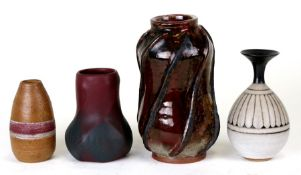 A group of Studio Pottery vases to include examples by Dennis Moore, the largest 19cms (7.75ins)