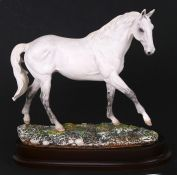 A limited edition Royal Doulton model of a horse - Desert Orchid - numbered 2932/7500, on a wooden