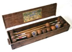 An early 20th century croquet set, cased,