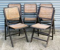 A set of five wooden folding garden chairs with cane backs and seats (5).