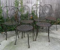 A set of six wrought iron garden chairs with lattice work seats (6).