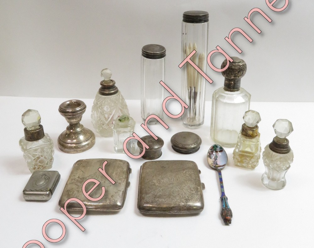 Lot 80 - A silver cigarette case; another silver cigarette case; four glass toilet bottles with silver