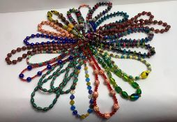 A quantity of costume jewellery bead necklaces, largely glass beads; of varying colours, designs and