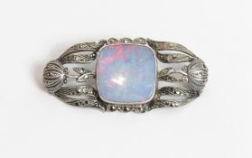 An opal doublet and marcasite set brooch, stamped '935', possibly German, 4.7 cm long by 2.2 cm,