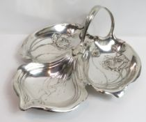 An Art Nouveau silver plated trefoil hors d'oeuvres tray, stamped with antler mark, possibly for WMF