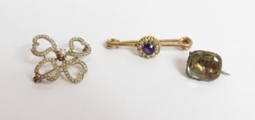 A gold Edwardian seed pearl brooch, unmarked, of four heart motifs enclosing a central small seed