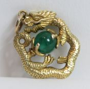 A gold dragon, clutching an emerald bead 'flaming pearl', stamped '14' and 'JS' to the jump ring,