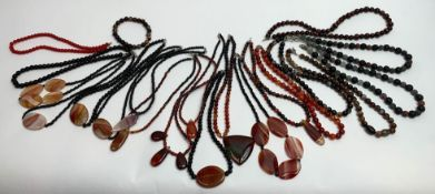 A quantity of gemstone bead necklaces to include carnelian, various agates, black onyx and lava;