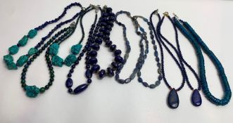 A collection of gemstone necklaces, including lapis lazuli, chrysocolla and turquoise; of varying