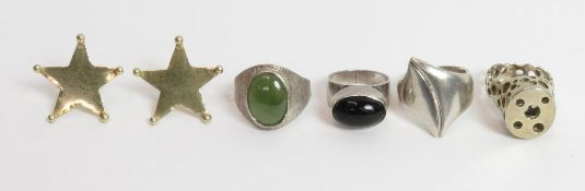 A Danish silver ring, stamped 'COF'; three other silver modernist rings; and a pair of silver gilt