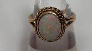 A 9ct gold opal single stone ring, finger size K, 3.4g gross