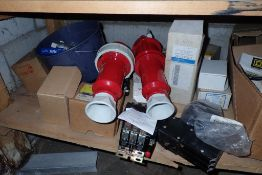 Contents of bottom shelf of parts including
