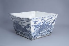 A large Chinese blue and white square 'sea dragon' jardiniere, 19/20th C.