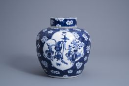 A Chinese blue and white prunus on cracked ice ground jar and cover with antiquities, 19th C.