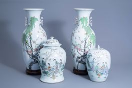 A pair of Chinese qianjiang cai vases with birds on blossoming branches and a vase and cover and gin