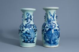 Two Chinese blue and white celadon vases with peacocks on a rock, 19th C.