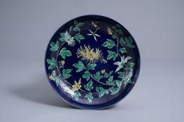 A Chinese dark blue ground 'chrysanthemum' dish, Kangxi mark, 19th/20th C.