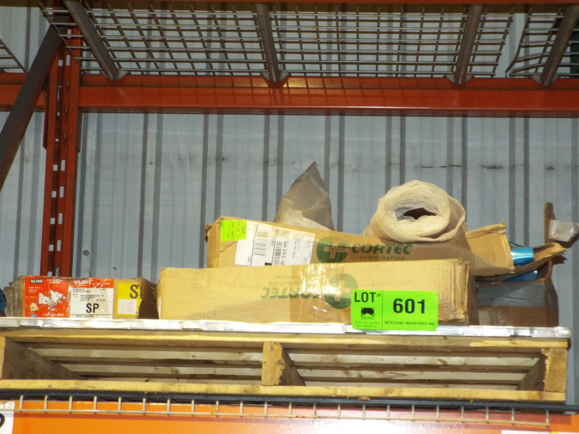 Lot 601 - LOT/ REMAINING CONTENTS OF RACK INCLUDING PLASTIC SHEETING, CARPET SQUARES AND SURPLUS MATERIAL