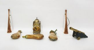 Three brass and copper powder flasks, a miniature brass model of a canon, two copper hunting horns