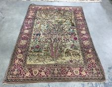 Eastern-style rug, the cream ground central field with Tree of Life decoration featuring various