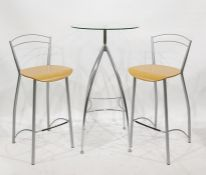 Circular glass and chrome based breakfast type table with two stools, a fire screen and a coffee