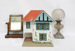 Doll's house, mirror and an oil lamp