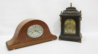 Bird's eye maple Napoleon hat shaped mantel clock, with Roman numerals to the oval dial marked 'La