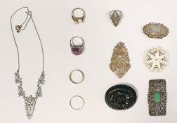 Jet-type oval floral brooch, a silver-coloured metal filigree pendant, a marcasite and jade-coloured