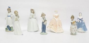 Lladro porcelain figure of a young girl with basket of oranges, four various Nao porcelain figures