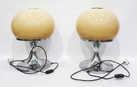 Pair of Harvey Guzzini Italian table lamps with circular silver coloured metal base and globular