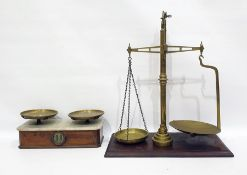 Set of brass scales and one further set of scales