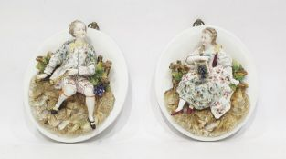 Pair (probably French) relief porcelain portrait plaques in the manner of Jacob Petit,