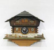 Swiss made three-train cuckoo and musical clockbased on an alpine chalet