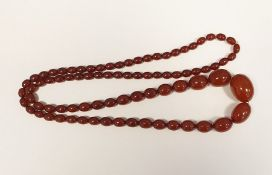 String of red amber-coloured graduated oval beads