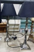 Pair silver coloured metal table lamps, with another (3)