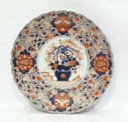 Large Japanese Imari chargerwith scalloped rim, central vase of flowers in circular reserve, all in