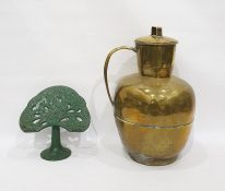 Large brass leaded jar and a cookery book rest in green iron