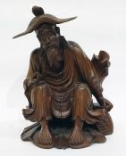Chinese carved boxwood figure of seated man, with detachable hat, 23cm high