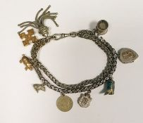 Silver-coloured metal herringbone-pattern chain braceletwith tassel and various charms
