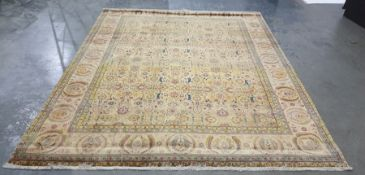 Golden ground Eastern rug with allover foliate decoration in pinks, greens, blues, yellows and