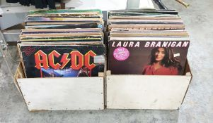 """Two boxes of 12"""" singles records to include examples by AC/DC """"Rock and Roll Ain't Noise"""