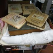 Quantity of table linen, etc and a quantity of booksto include Beatrix Potter titles, R K