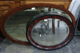 Bevel edged oval mirror with carved wooden frame and another (2)