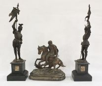 Pair of spelter figures bearing flags, raised on black slate bases and further spelter figure of man