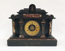 Black slate and rosso marble mantel clock in the Greco-Roman architectural taste with Roman numerals