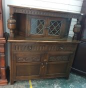 20th century oak reproduction court cupboardwith two leaded glazed doors to the upper section above